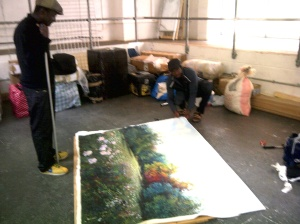 Artist Titus preparing his painting entitled 'Family & Beyond'